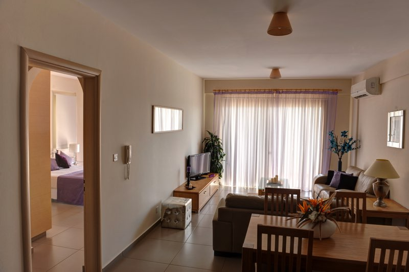 paphos one bedroom apartment holiday rental living room in Aphrodite Sands Resort
