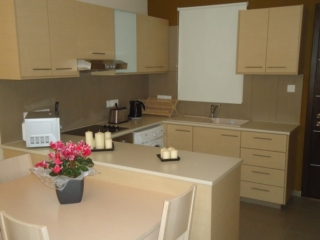 White kitchen of one bedroom apartment at Paphos Aphrodite Sands Resort