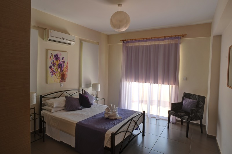 King size bed of one bedroom apartment at Paphos Aphrodite Sands Resort