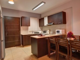 Kitchen of three bedroom apartment at Paphos Aphrodite Sands Resort