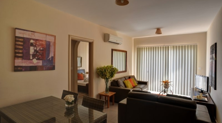 Seating area of three bedroom apartment at Paphos Aphrodite Sands Resort