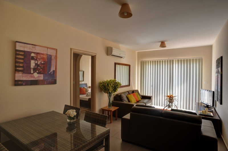 Sitting area of three bedroom apartment at Paphos Aphrodite Sands Resort
