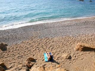 Sunbathing at the beach near Paphos Aphrodite Sands Resort