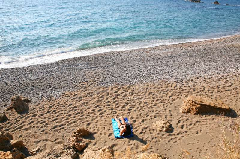 Sunbathing at the beach near Paphos Aphrodite Sands Resort
