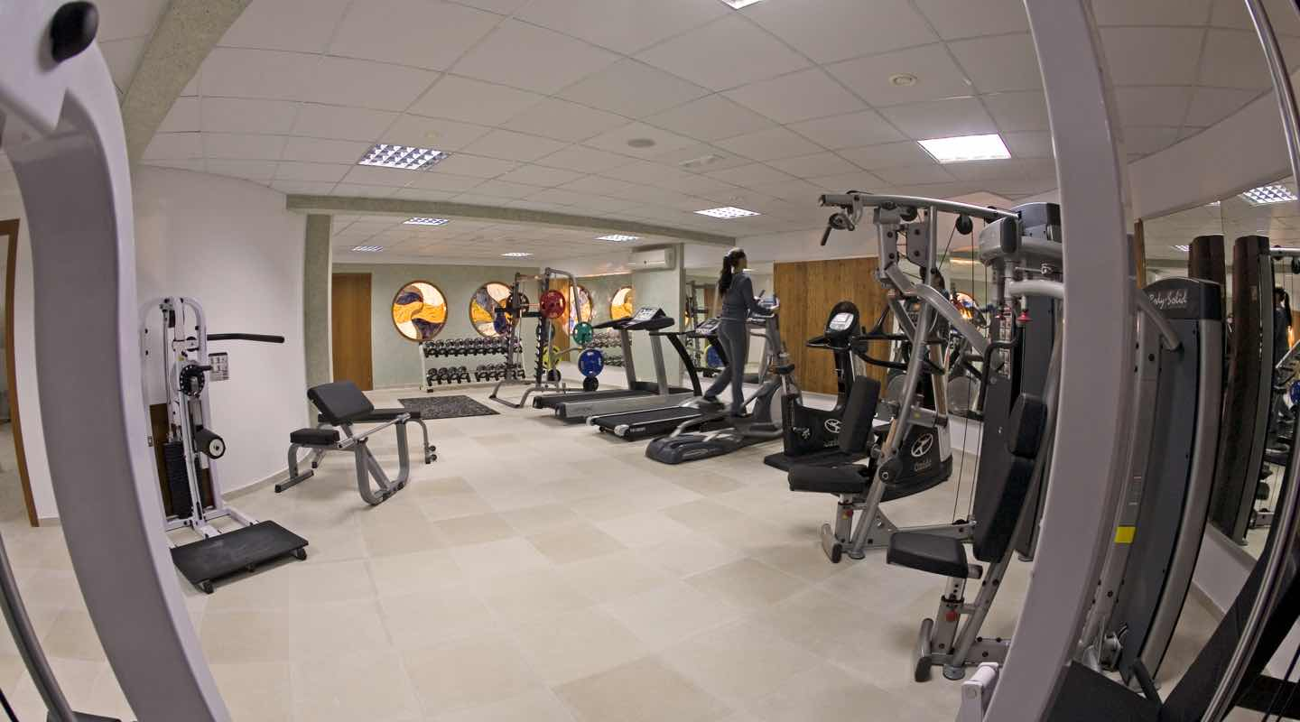 Woman exercising in the gym of Paphos Aphrodite Sands Resort