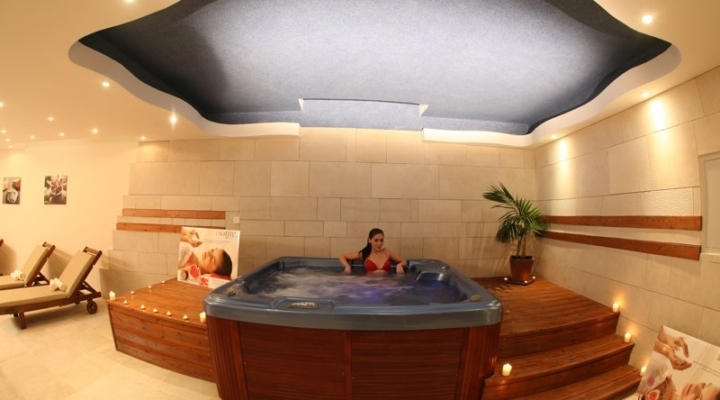 Girl enjoys the jacuzzi at Paphos Aphrodite Sands Resort