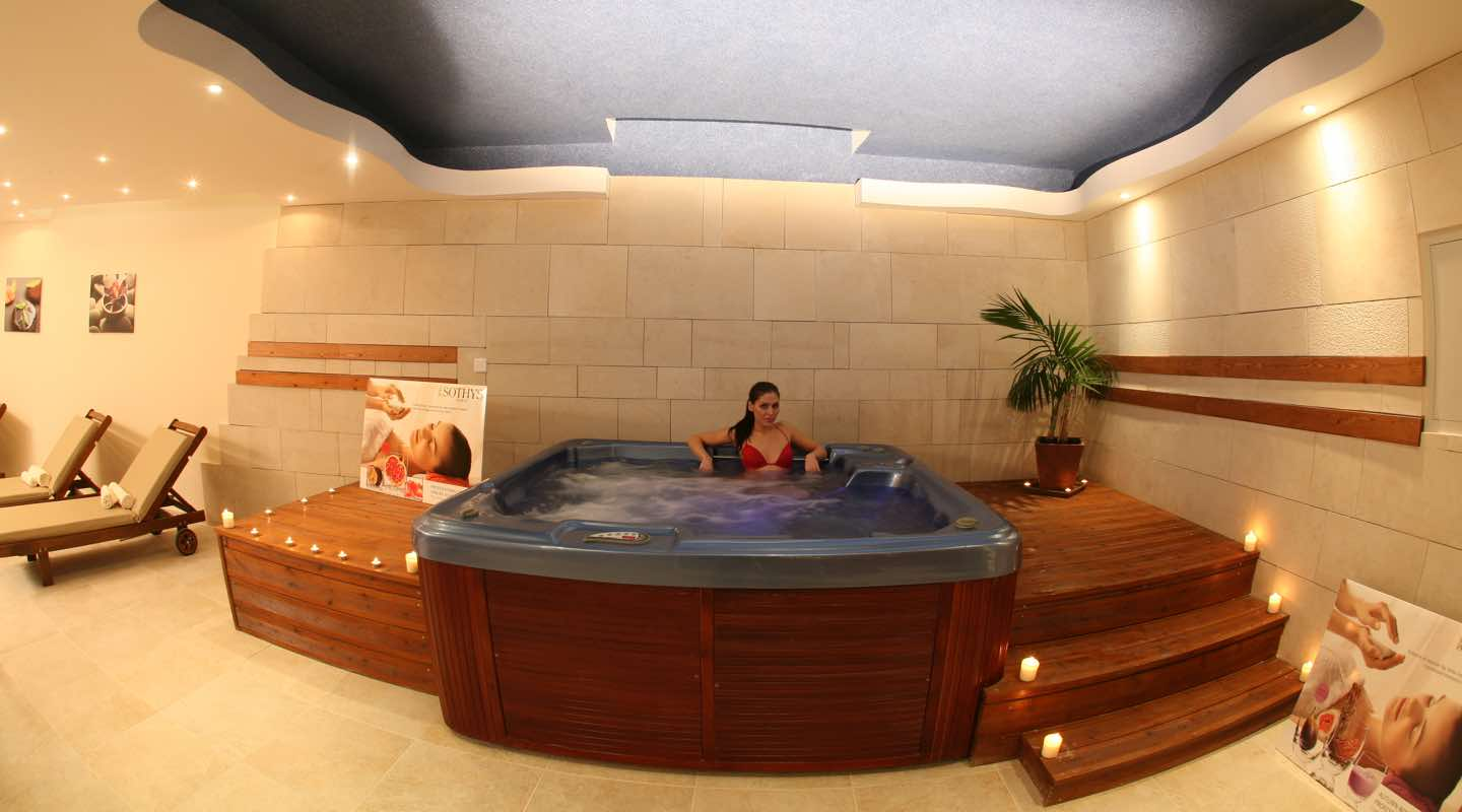 Woman enjoying the jacuzzi in Paphos Aphrodite Sands Resort