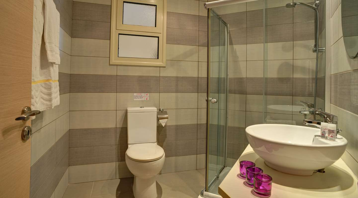 Bathroom of one bedroom apartment at Paphos Aphrodite Sands Resort