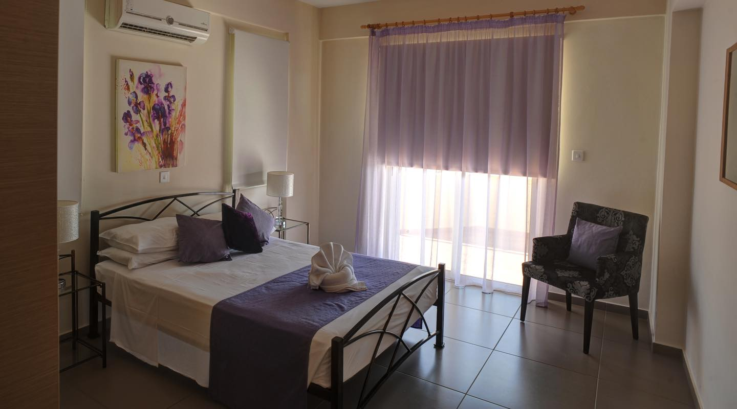 Colours of bedroom of one bedroom apartment at Paphos Aphrodite Sands Resort