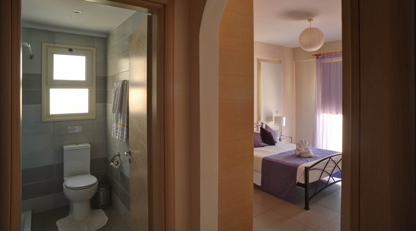 Bedroom and bathroom of one bedroom apartment at Paphos Aphrodite Sands Resort
