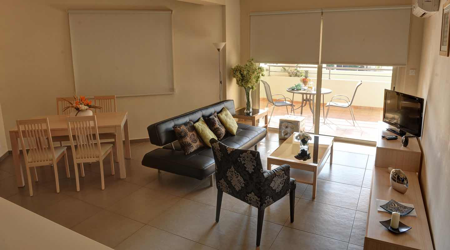 Living area of one bedroom apartment at Paphos Aphrodite Sands
