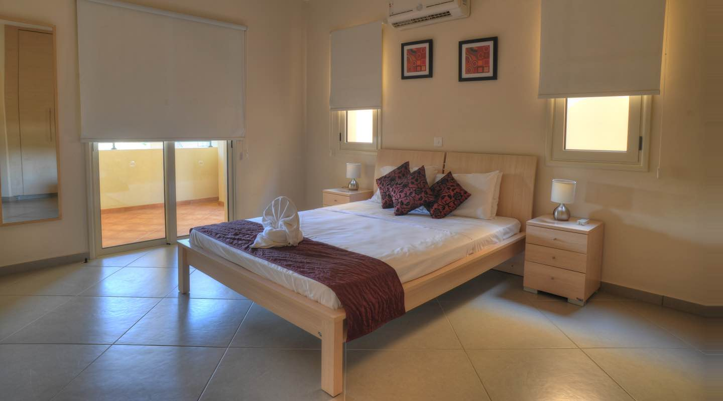 Double bed of one bedroom apartment at Paphos Aphrodite Sands Resort