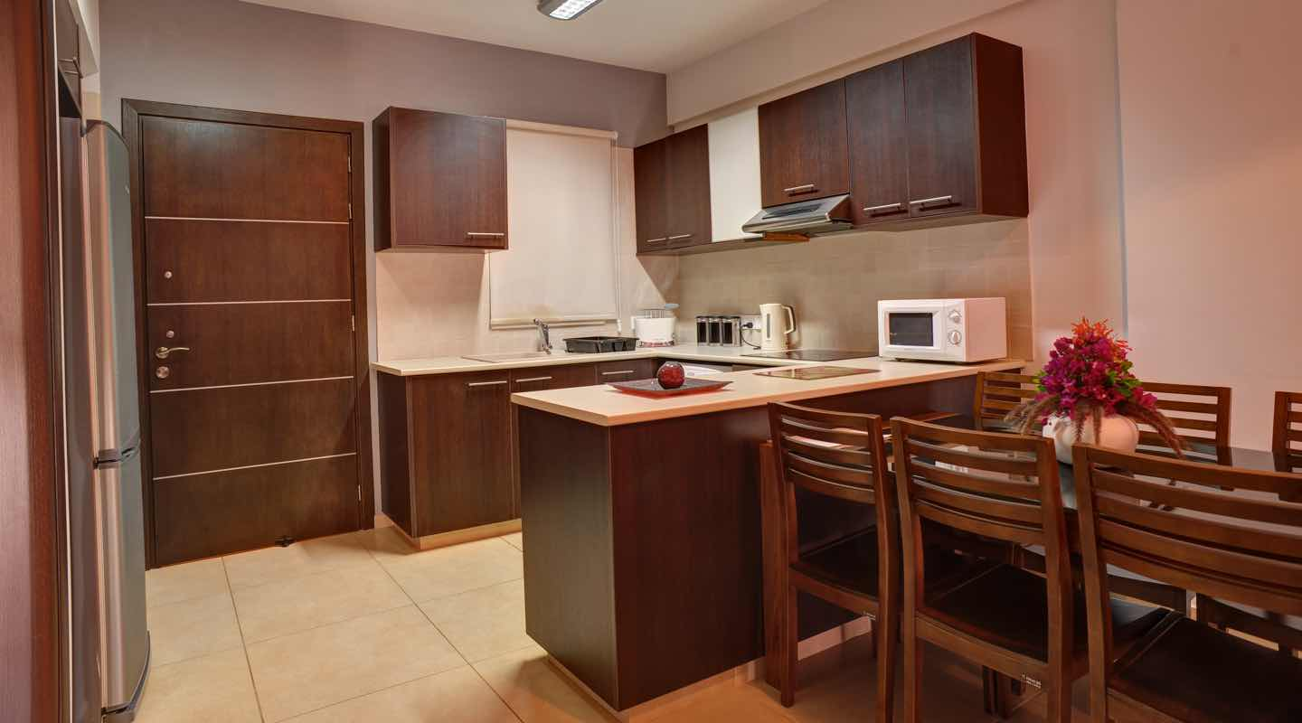 Wooden Kitchen of three bedroom apartment at Paphos Aphrodite Sands Resort