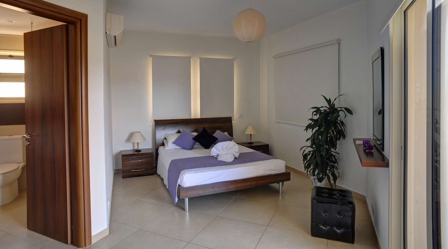 Master bedroom of three bedroom apartment at Paphos Aphrodite Sands Resort