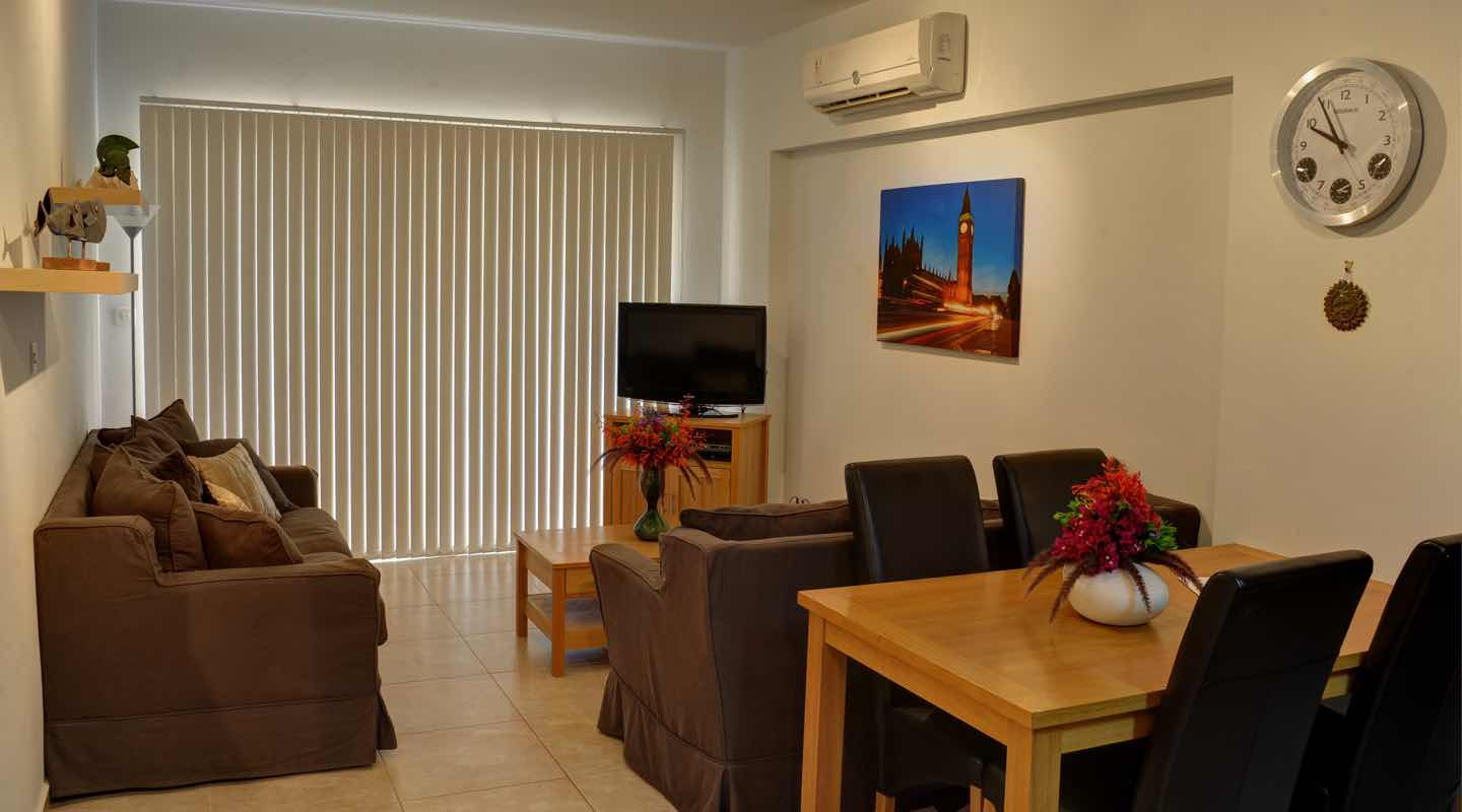 Dining and Living area of two bedroom apartment at Paphos Aphrodite Sands Resort