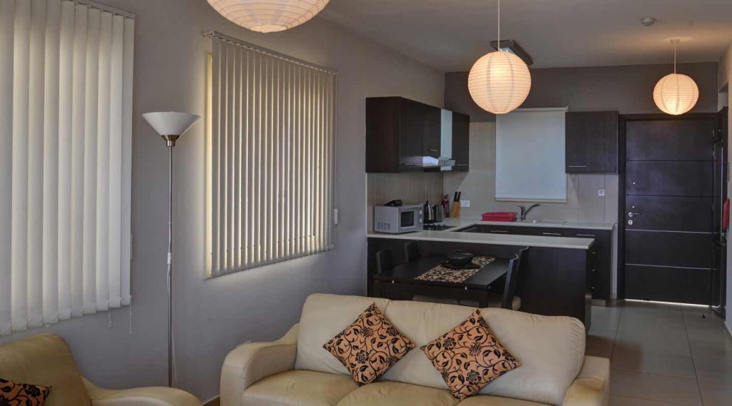 Kitchen And Living Area Of Two Bedroom Apartment At Paphos Aphrodite Sands Resort