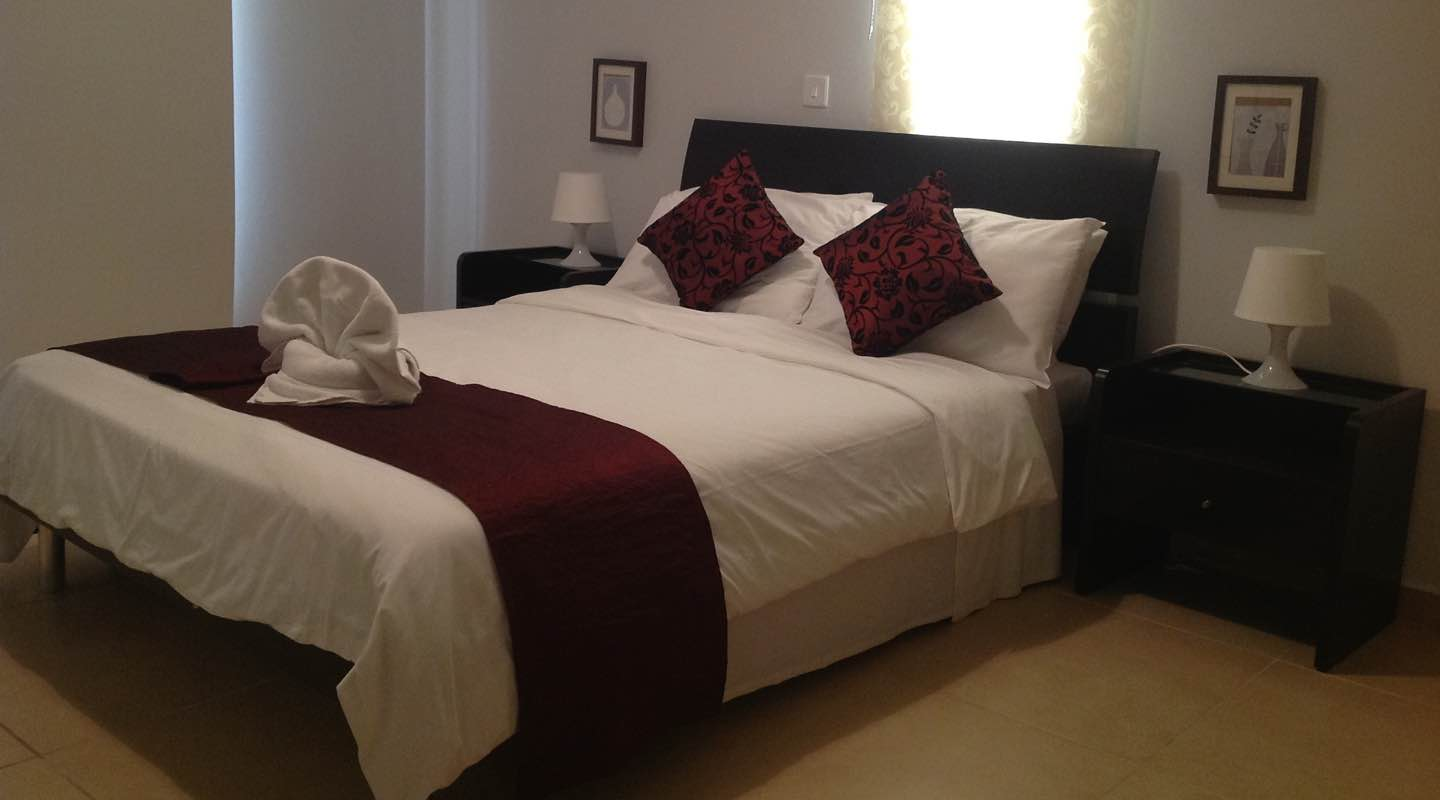 Red Master bedroom of two bedroom apartment at Paphos Aphrodite Sands Resort