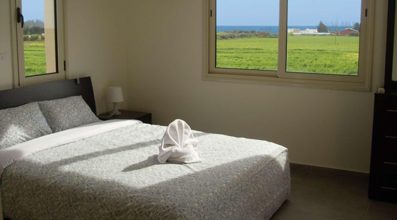 King size bed of Villa at Paphos Aphrodite Sands Resort