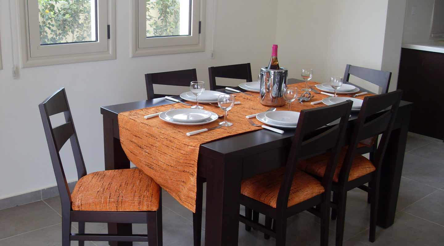 Dining Table with orange cover of Villa at Paphos Aphrodite Sands Resort