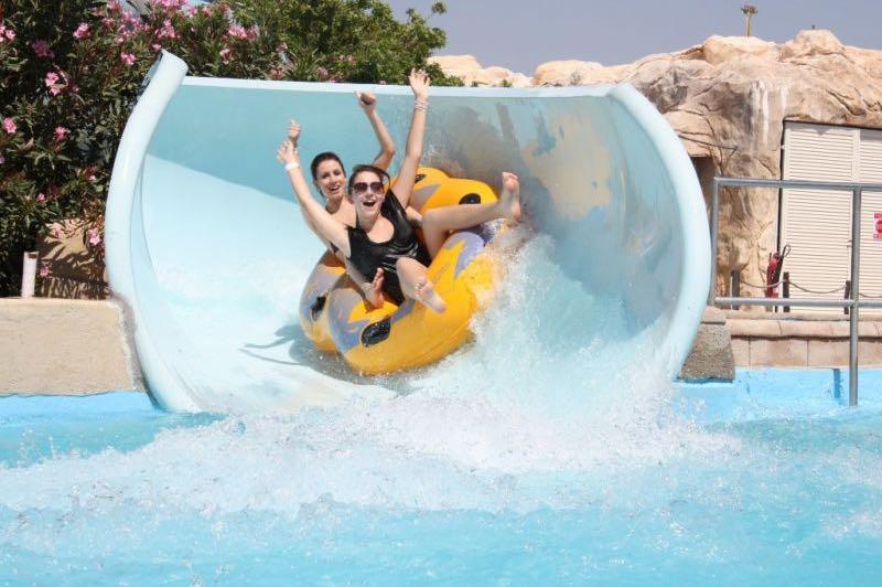 Girls at Paphos Aphrodite Waterpark free fall slider