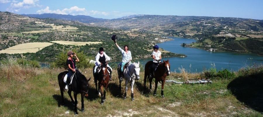 Horse riding on the hills by the water dam