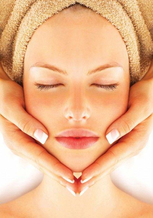 Woman Facial Treatment in Spa Centre